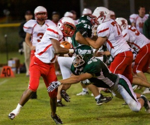 Running back Khari Haynes evades a tackle on the line of scrimmage