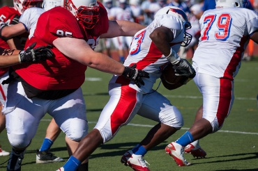 Spencer Wheeler attempts to make a tackle in Redwood's home opener against Tam.