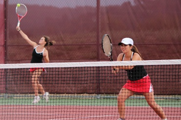 Sophomore Paige Silverman waits as freshman Abby Mullens serves during a match at Redwood.