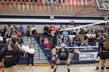 Junior Sophie DiGrazia blocks a Marin Catholic spike. Redwood swept the Wildcats in 3 games.