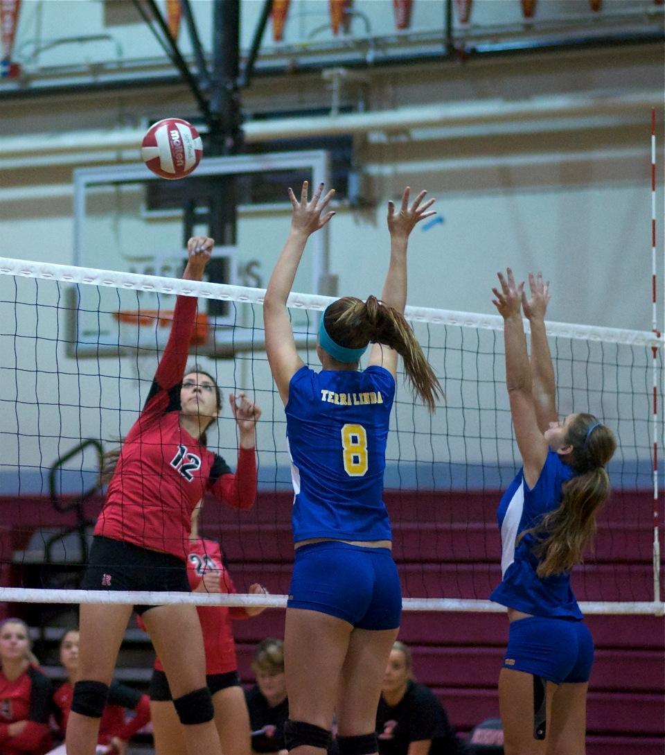 Gallery: Girls' volleyball trounces Trojans