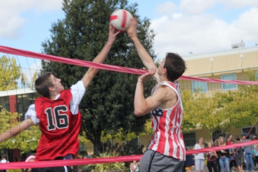 Peter Kennedy blocks a kill from Tyler Jackson in Monday's intramural volleyball game.