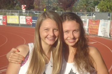 Megan and Rachel pose together on the Redwood track before a recent practice.
