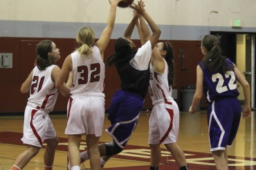 Redwood blocks a Piedmont layup attempt on Tuesday night in Larkspur.