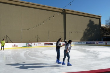 Skaters enjoy the new Northgate ice rink.