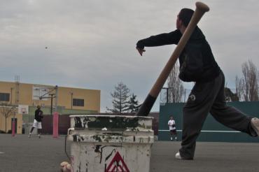 Junior Zak Lyons plays catch during an offseason baseball practice.