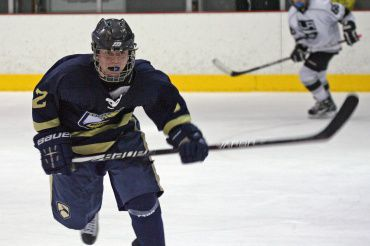 Cole Adaskaveg skates towards the puck in his youth hockey game for Golden State Elite Eagles hockey club.