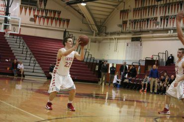 LOGAN MCGUIGAN SHOOTS a three point shot during a game two weeks ago against Branson.
