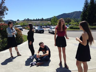Seniors rehearse in front of the Little Theater in preparation for the April 18 performance.