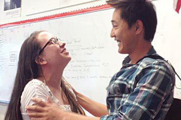 "SENIOR YODAI YASUNAGA embraces his Prom date, senior Jenny-Marie Stryker, after performing his cover of Bruno Mars's ""Marry You"" for her during her AP Spanish class."