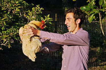 SENIOR GIDEON ELSON holds his chicken at his home. For more images, check out the gallery.