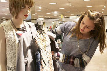 HOLDING  UP HER outfit to a mannequin, junior Taryn McCarthy and BP fashion board member examines her creation at the Corte Madera Nordstrom.