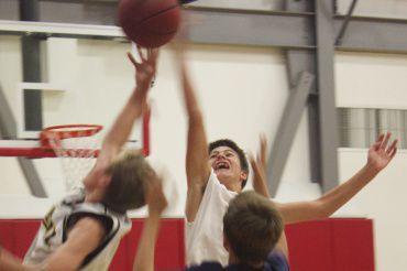 Freshman basketball player, Blaise Van Brunt, reaches for the rebound during open gym