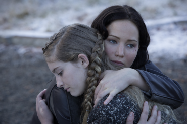 TRAUMATIZED by her experience in last year's Games, Katniss Everdeen (Jennifer Lawrence), hugs her sister Primrose Everdeen (Willow Shields). Lawrence captured Katniss's emotions with just her eyes.
