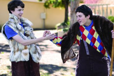 James Harding, the clown in The Winter's Tale production, explains to his shepherd father, played by Leo Zaklikowski (right), that he discovered a baby and a bunch of gold in the woods in a rehearsal in the Quad.