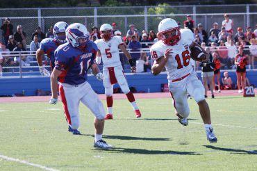 Senior running back Joe Kasselik sprints for the pylon during a touchdown run against Tam last month.