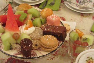 "Brownies, assorted fruits, and pastries are delightfully served in the ""Lords & Ladies Cream Tea"" platter at Secret Garden Tea House in San Francisco"