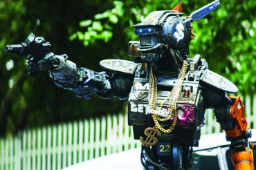 "The robotic protagonist of the film, ""Chappie,"" aims a weapon in the beginning of the movie, which premiered on March 6."