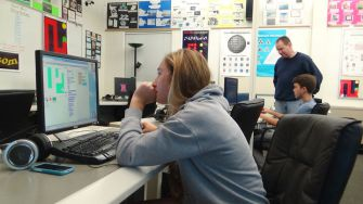 Seniors Shaya Barry (front) and Matt Berry (back) code during workshop day, Oct. 14.