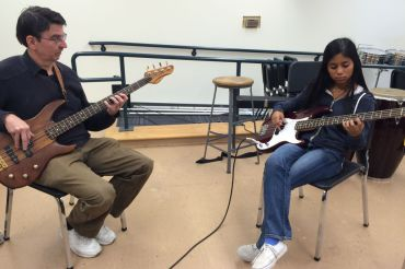 Miranda Overson practices bass with a professional instructor,