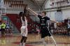 Junior Jordan Jackson shoots a contested pull-up jumper over junior Joey Calcaterra.