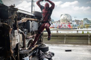 Deadpool attacks his enemies after a car chase.
