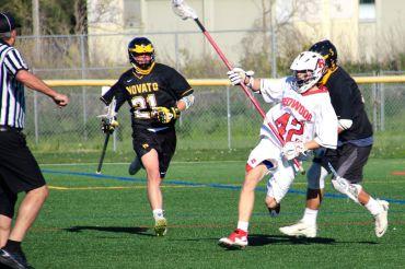 Senior Cole Wilhite outruns Novato aggressors.
