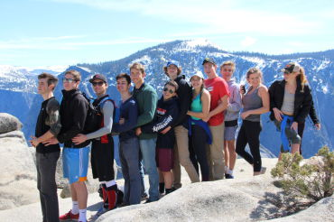 Arriving at the top of Nevada Falls, students of the music department pose together before beginning the long trek down.  The musicians spent a weekend hiking together in order to enhance bonds within the class.