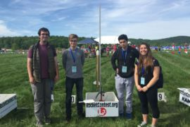 (from left to right) Senior Kevin Makens,  Juniors Filip Platek, Joseph Alavi, Ashlyn D'Orazio stand next to their handmade rocket on May 14 in the Plains, VA at the launching site.