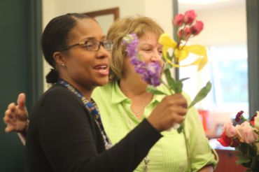 Ms. White smiles as she receives flowers Wednesday morning.