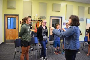 Leading chorus students in vocal exercises and song covers with multiple harmonies at the second chorus class, Martone teaches a program that is open to students of all grade levels and meets on Thursday nights.