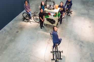Members of Amos' team bike there machine which recycles plastic from 3-D printed projects.