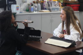 Teaching flute lessons to students at MLK-Bayside Middle School on a Saturday morning, freshman Emily Comins volunteers at the Sound Waves Program.