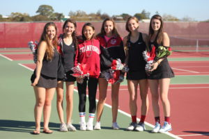 Seniors on the team pose with their presents after ceremony celebrates their last regular game on the team