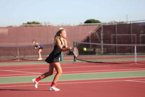 Sophomore Lilly Blanadet prepares to hit the ball in final match of the season before playoffs