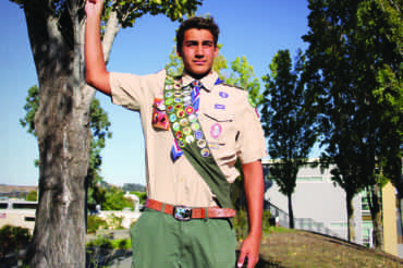 Senior Wyatt Barker holds up his hand in the Boy Scout three-fingered salute.