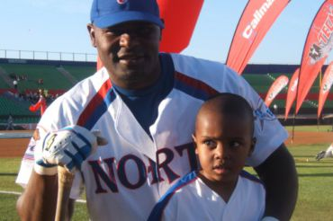 Posing with his father, DJ White sees his father as a role model and a mentor, though he no longer plays baseball.
