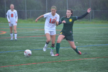 Freshman captain Delaney Anderson battles with San Marin for the ball