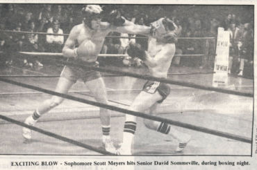 EXCITING BLOW - Sophomore Scott Meyers hits David Sommeville, during boxing night.