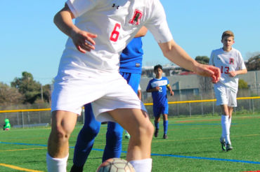Sophomore Nathaniel Kuffner shields a defender as he controls the ball.