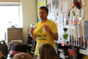 A member of Amnesty International talks to the club during their meeting on Thursday.
