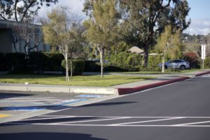 Formerly white-colored spots were painted red, further minimizing student parking