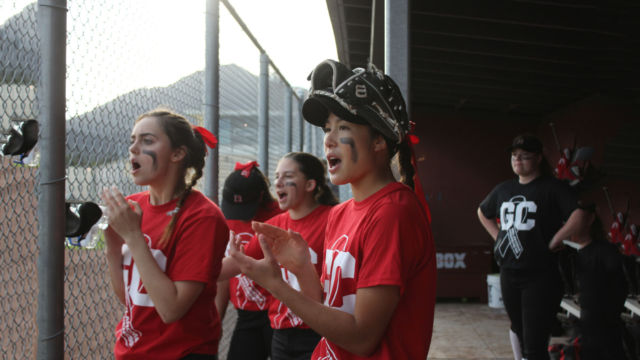 Left to right, senior Ali Lee, junior Grace Marshall, senior Sabrina Nunez, junior Cami Klemme cheering on their teamates