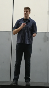 """Standing at 6'11,"""" Kevin Laue spokeat the Passion Week assembly."""