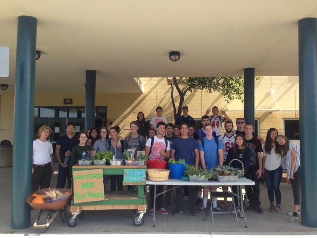 Selling produce outside of school, the Sustainable Agriculture class will be offered in a new program that combines it with Government and Economics.