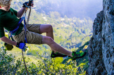Sophomore Niklas Korn rappels down a steep cliff.