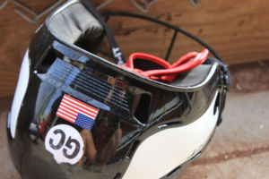 """Many players had """"GC"""" stickers on the back of their helmets."""