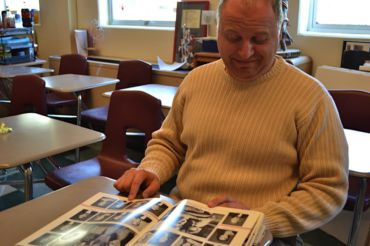Mr.Hirsch making a surprised face when looking into one of his old yearbook from the year 1994.