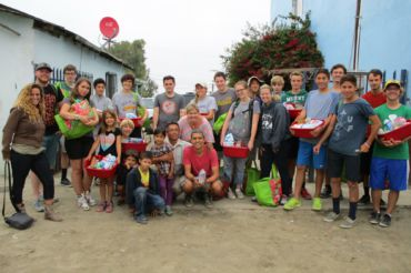 Standing with his mission group, junior Jake Hanssen spends time in Mexico using his Spanish skills.