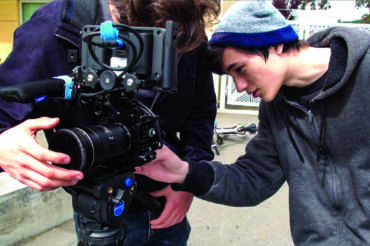 Garet Jatsek adjusts a camera during the production of a Redwood TV episode.